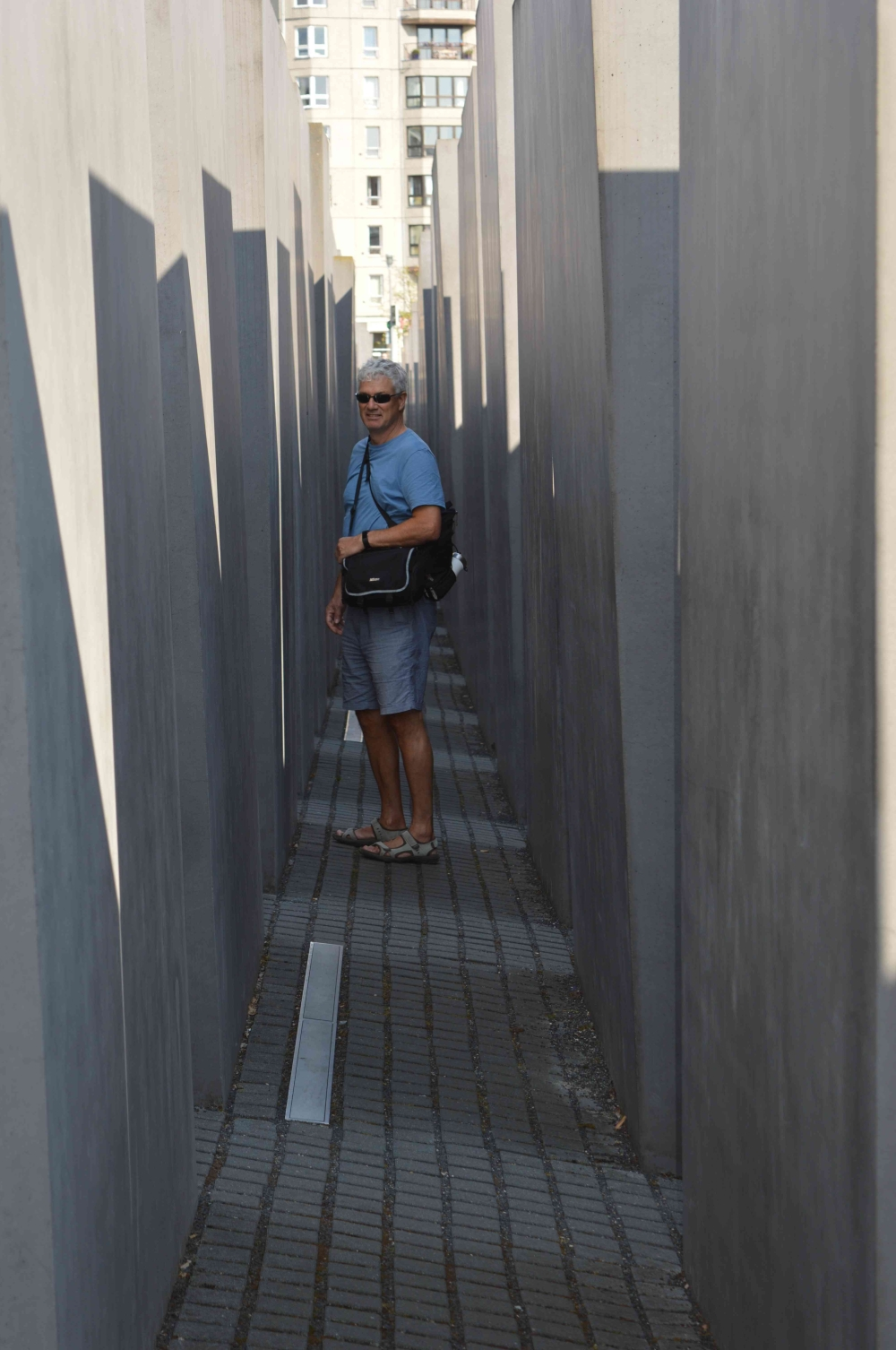 Doug standing between the blocks of the Memorial to the Murdered Jews of Europe in Berlin